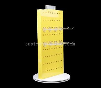 Custom acrylic pegboard display stand
